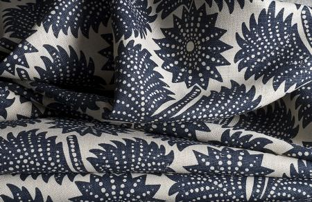 Threads -  Meander Fabric Collection - Fabric dyed in white decorated with a modern pattern of dark blue leaves adorned with white dots