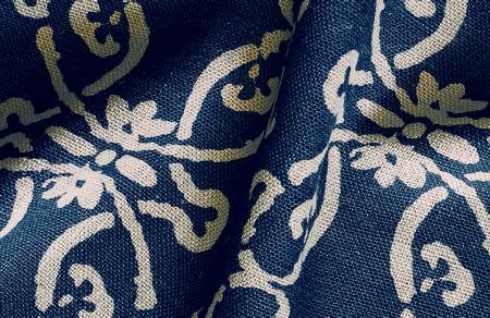 Threads -  Variation One Fabric Collection - Fabric dyed in a dark shade of blue decorated with a modern pattern of flowers in colour white