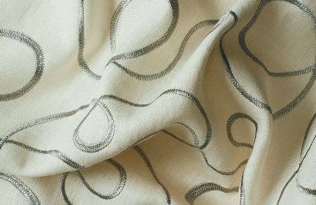 Threads -  Variation One Fabric Collection - Fabric dyed in colour light beige decorated with an elegant swirly design in colour silver