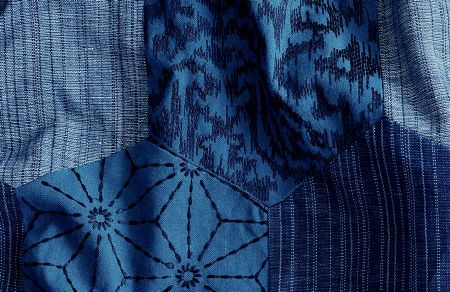 Threads -  Variation Two Fabric Collection - Fabric decorated with an interesting pattern of patches in different shades of blue and with different designs