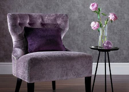 Wemyss -  Ashton Fabric Collection - A velvet textured light lavender coloured armchair, a plain, dark purple cushion, a small round black table and a vase