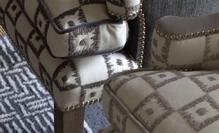William Yeoward -  Astasia and Monsoreto Fabric Collection - 2 armchairs covered with embroidered, textured checked designs in dark brown and light grey on cream fabric, with a rug