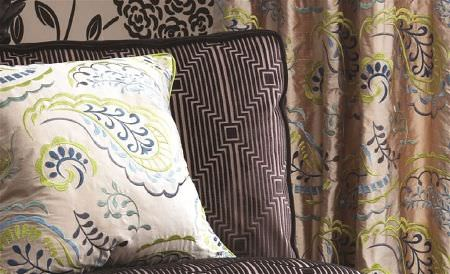 William Yeoward -  Delacroix Fabric Collection - Lustrous caramel, navy and citrus curtains with a matching patterned cushion, and a geometric black and silver seat