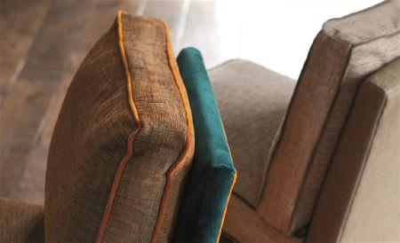 William Yeoward -  Library I Fabric Collection - Light brown and teal coloured plain fabric chairs with square seat cushions edged in bright orange and dark brown piping