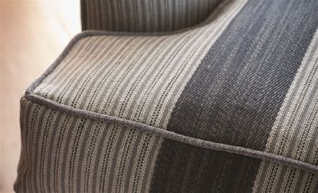 William Yeoward -  Marlena and Alberesque Fabric Collection - An armchair upholstered with woven fabric featuring a wide and narrow striped design in off-white, ash grey and charcoal