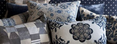 William Yeoward -  Marlena and Alberesque Fabric Collection - A polka dot background to 7 different patterned, plain and textured cushions made in off-white, grey and dark blue