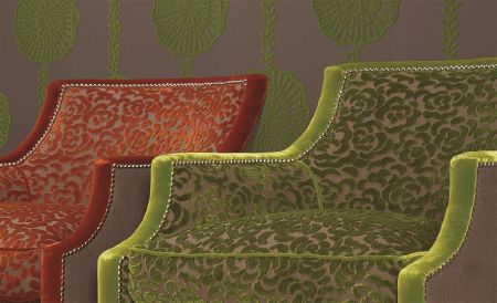 William Yeoward -  Valois Fabric Collection - Two mocha coloured armchairs featuring flocked lime green and burnt orange floral patterns and co-ordinating plain arms