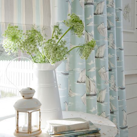 Clarke and Clarke -  Maritime Prints Fabric Collection - Pale blue boat print curtain and striped roman blind